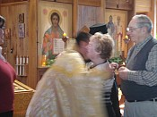 Father greets Beverly & John Kuzmich at the end of the service.